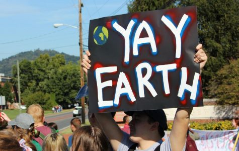"Bridgewater junior Josh Sprouse, photographed holding the ""Yay Earth"" sign, said, ""As a member of Eco-Action, I participated in the climate strike because what's happening to our planet isn't healthy. I love working in nature and observing what beauty there is, but in 50 years or so, there won't be anything for me or other botanists, mammalogists, or biologists to observe and appreciate. We have to start making a change now since there's no turning back."""