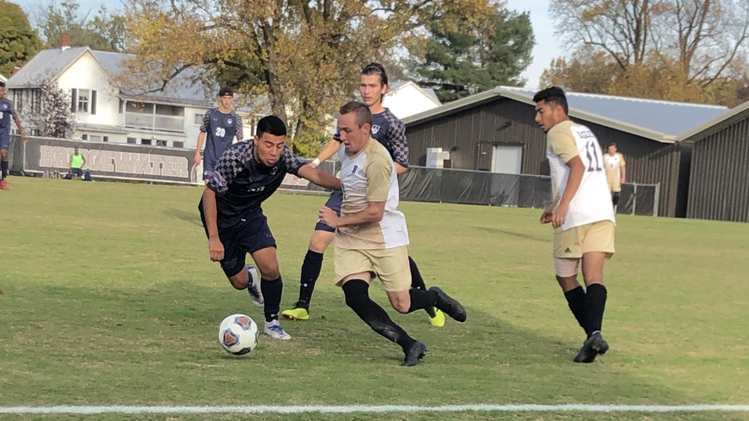 Sophomore defender for the Eagles, Justin Thorburn, fights for the ball in the first half.