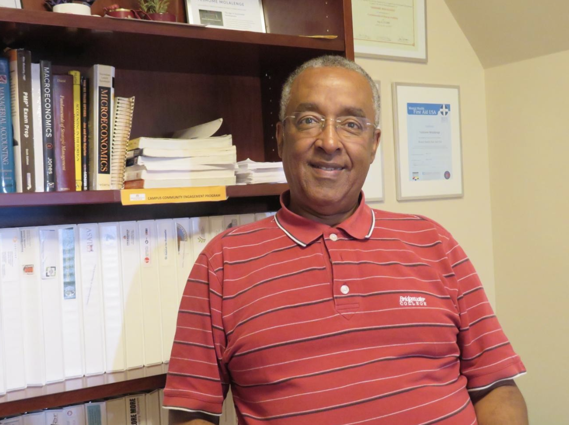Teshome Molalenge in his office in the Center for Engaged Learning, 2nd Floor