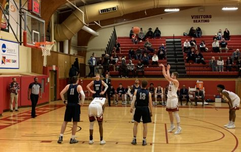 Sophomore guard Liam Caswell takes a foul shot in the men's basketball game against the Mary Washington Eagles.