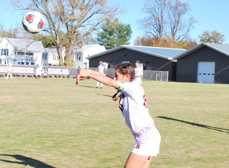 Senior midfielder, Sydney Ryan throws the ball in.