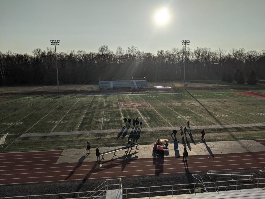 The+sun+sets+over+the+field+after+Bridgewater+capped+off+its+perfect+season.+The+glare+of+the+logo+shines+as+bright+as+the+Eagles%E2%80%99+ODAC+trophy.