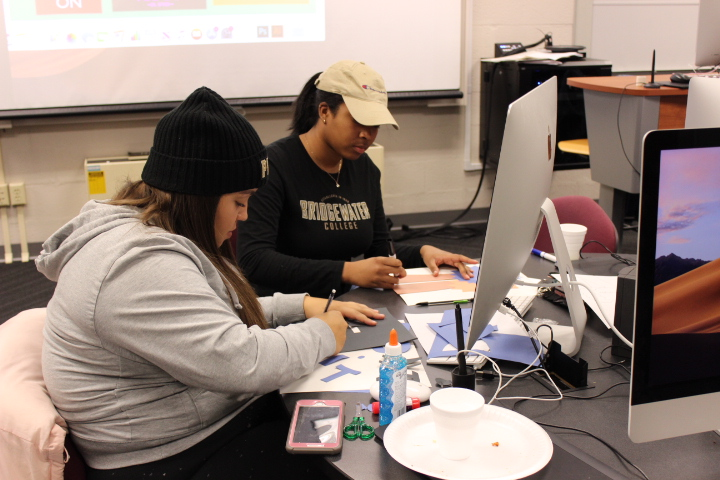 Seniors Naila Lyles (right) and Jazzlynne Miller (left), make PSA posters. They are not only using digital technology, but also utilizing skills they already have.