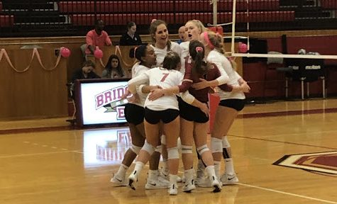 The Eagles celebrate after scoring in the first set.