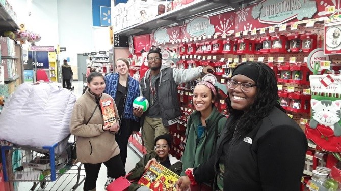 Cassandra Zendarski (far left), Sarah McIntyre (middle left), Kameron Kyles (middle), Laraya Billups (seated), Brittany Utley (middle right), and Kennesha Parker (far right) are members of the Student Support Foundation. As a volunteering activity, the members went to Walmart to buy presents for the Boys and Girls Club.