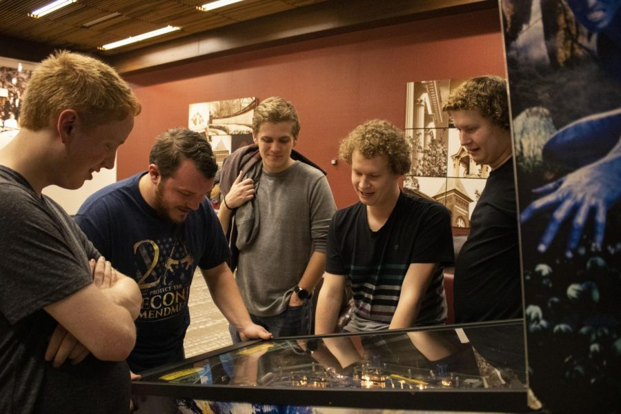 Sophomore Jared Browne plays Avatar Pinball while his friends gather and watch.