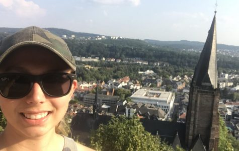 Junior Erika Spaulding at the Marburg Castle overlooking the city of Marburg, Germany behind her. Spaulding spent the fall semester of 2019 in Marburg, Germany for a semester abroad.
