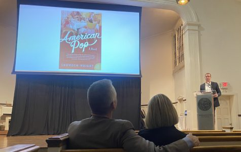 Snowden Wright stands behind the podium as he reads an excerpt of his novel American Pop.