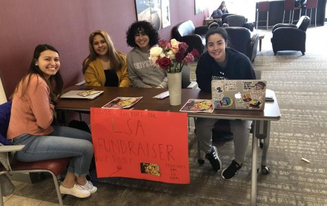Students from the Latin Student Association selling roses in the KCC Lobby.