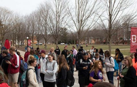 Students and faculty gather at the entrance of the Learning Commons' vestibule, waiting for the doors to open at 1 p.m..