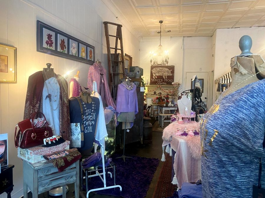 The new boutique sells womens clothing, jewelry, and other items like candles.