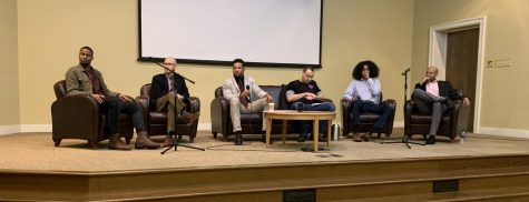 Deshon Holmes, Neil Rittenhouse, Austin Vaughan, David Reznick, Daniel Jones, and Obie Hill answer questions from the audience about what masculinity means to them.