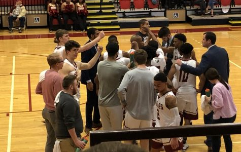 Bridgewater men's basketball huddles up during a 2020 home game against EMU. The Eagles will be joined by two new assistant coaches this upcoming season.