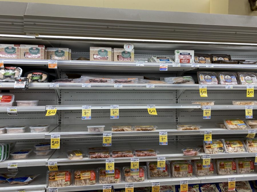 The Safeway Grocery store's lunch meat aisle shows some promise of items, unlike much of the surrounding aisles and shelves.