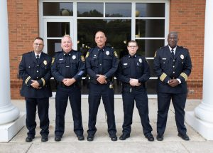 (Left to right): Lieutenant Rick Biller, Officer Thomas Holsinger, Officer John Painter, Officer Justin Shipley and Milton S. Franklin, Jr. Chief of Police. The Campus Police Officers are collaborating with local agencies to determine emergency management procedures during the pandemic.