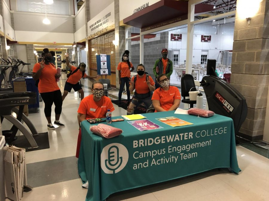 CEAT crew members prepare to welcome first-year students to a showing of Jumanji 2 held at the Funkhouser Center during Welcome Week. The event involved the Covid-19 policies now typical at all CEAT events, including RSVPs and wearing masks.