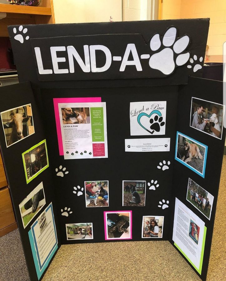 Lend-A-Paw's board from the Student Engagement Fair, which showed general information about the club and its activities.