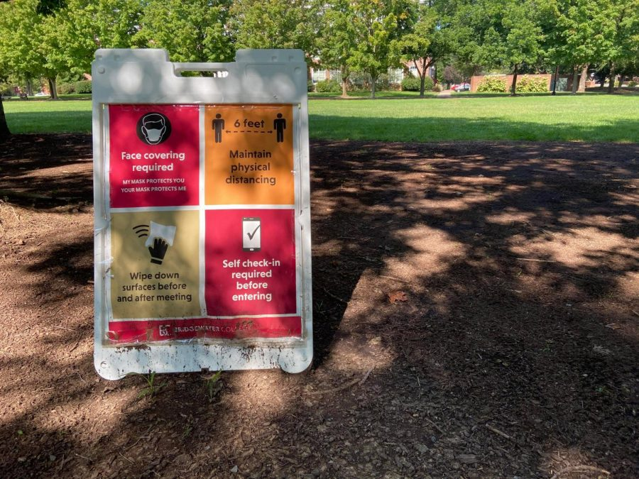 The college has set out signs across campus reminding students to wear a mask, social distance, wipe down surfaces and do their self check-in.