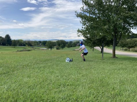 Sophomore Ben Riddle winds up to throw the disc to one of the longest holes on the course. To be a successful disc golfer the ability to keep the disc going straight is a priority, and Ripple controlled his throws throughout all nine holes.