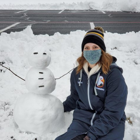 First-year student Katie Tolone and snowman