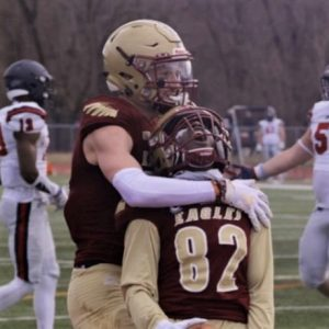 Sophomore wideout Derrick Jenkins celebrates with senior wideout Chad Jones after scoring his second touchdown of the game. The Eagles defeated the Hornets of Shenandoah University 27-21.