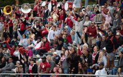 Fans cheering for BC Eagles at Homecoming football game
